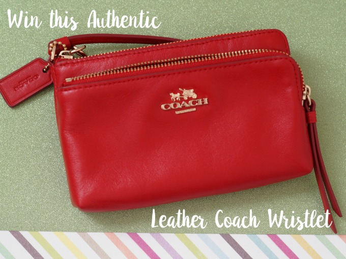 win this coach wristlet