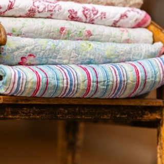 quilts in a rustic chair