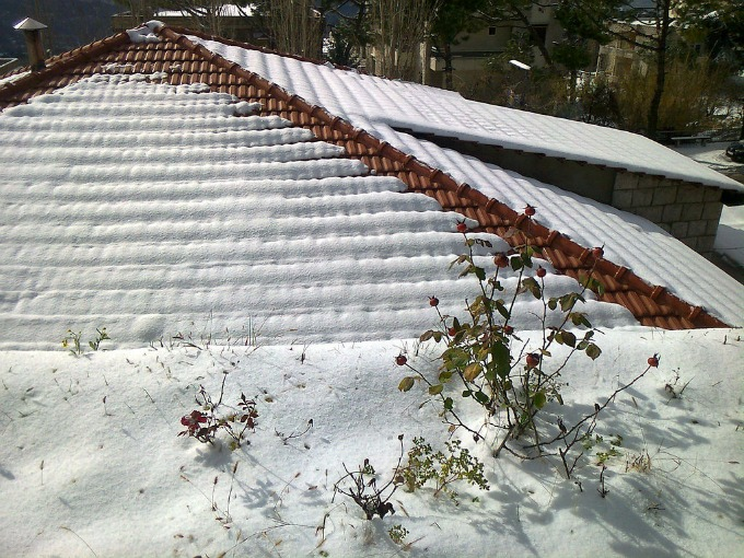 snow covered tile roof