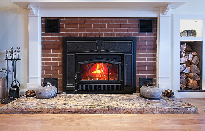 Natural stone used as a hearth in a fireplace update