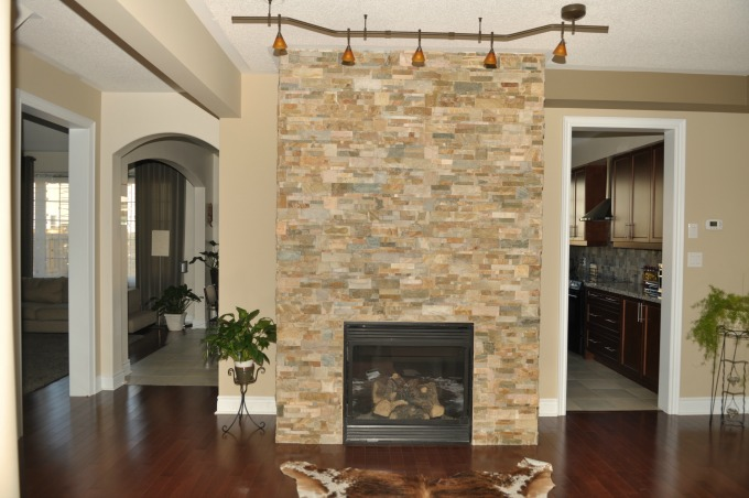 Stacked stone or slate are great choices to update your fireplace