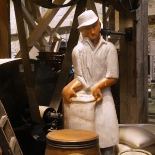 wood carving of mill worker at Mill City Museum in Minneapolis, MN
