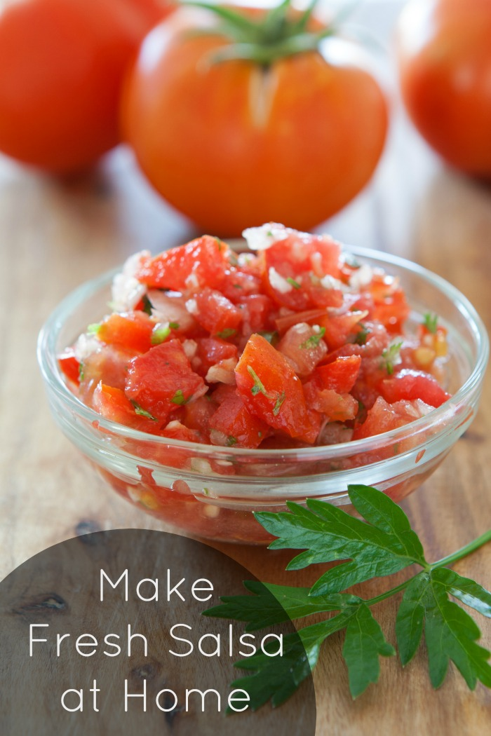 How to make garden fresh salsa at home. This recipe is so quick and easy, and delicious, that you won't want that jarred stuff again. Serve with vegetables, chips, tacos, or just about anything.