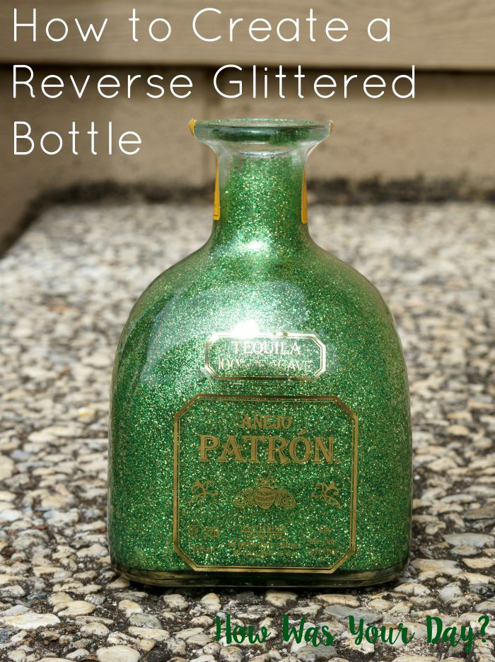 Reverse glittlered Patron bottle on counter.