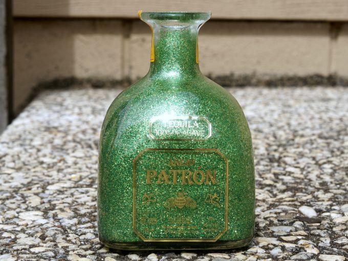 Reverse glittered Patron bottle lead