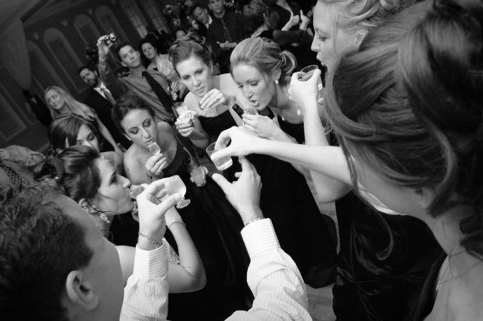 wedding party doing shots Original Wedding Venue Ideas