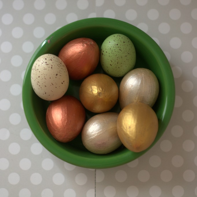 faux gilded easter eggs in green bowl