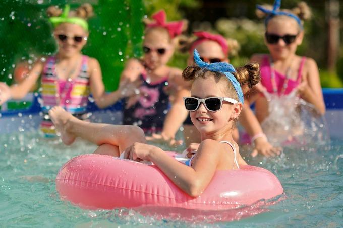 girls splashing in the pool