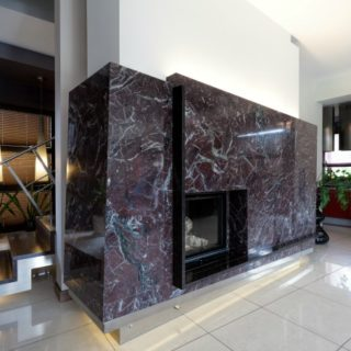 Modern fireplace covered with black marble