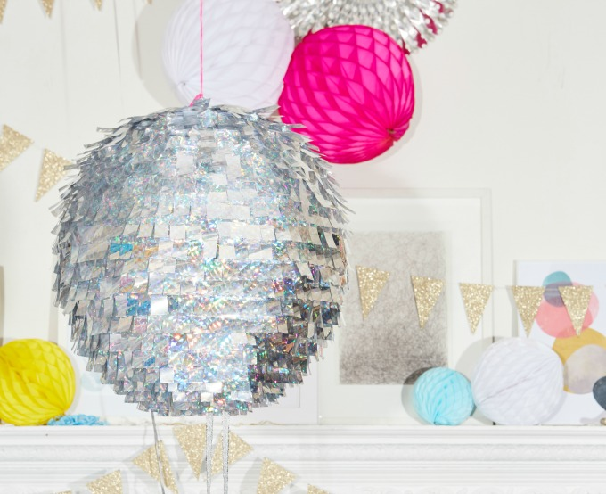 DIY disco ball in front of mantle