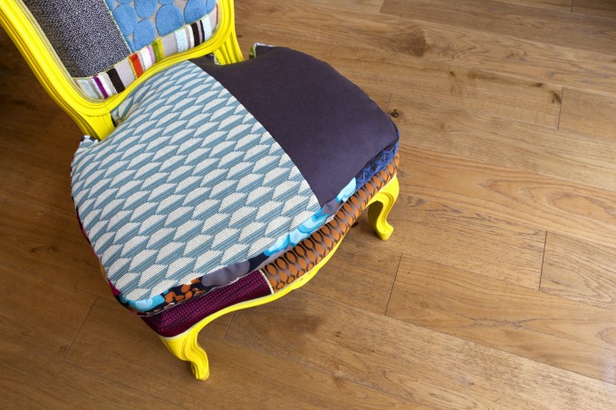 customize an old chair with some paint and new upholstery