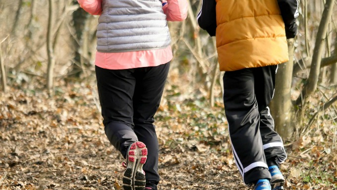 Jogging with a fitness friend helps both of you reach your goals