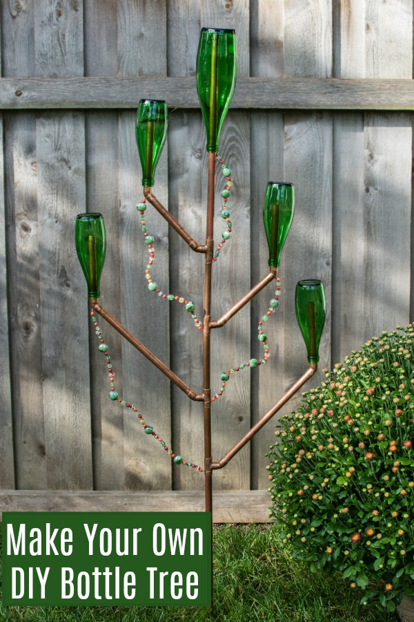 Make this gorgeous DIY Bottle Tree for your yard or garden. The easy to follow instructions in the tutorial are sure to bring you success