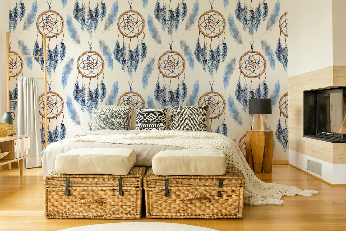 Boho Chic style bedroom with wicker baskets and dreamcatcher mural