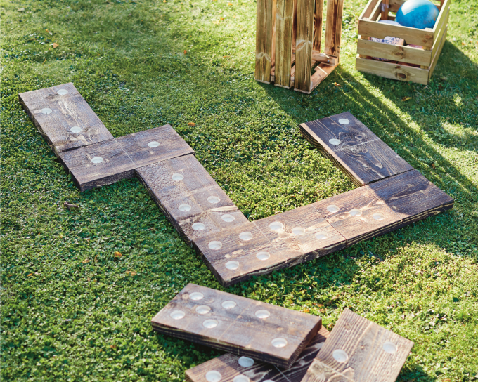 Giant outdoor yard dominoes in the grass