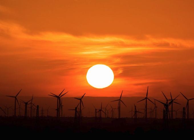 sun over wind mills