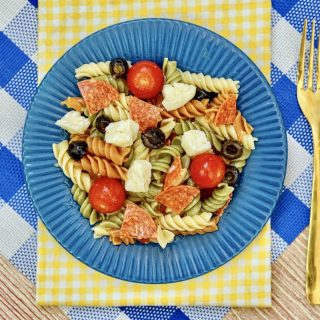 a blue plate filled with pasta salad
