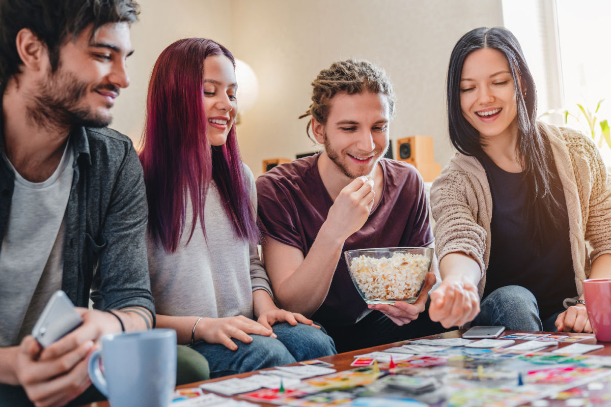 Young adults playing board games